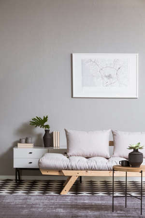 White map on gray wall in fashionable living room interior with scandinavian futon