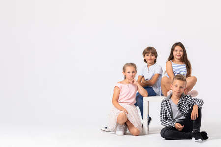 Group of cool children fooling around and making funny poses