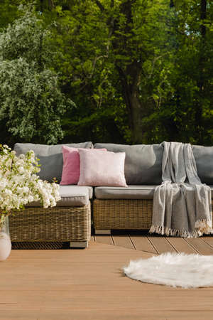 Beautiful green garden with wicker terrace furniture and trees Stock fotó