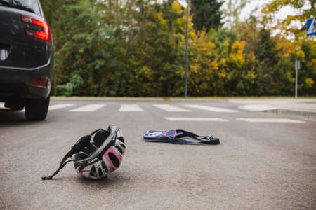 Kid's debris on the road after hitting by a car