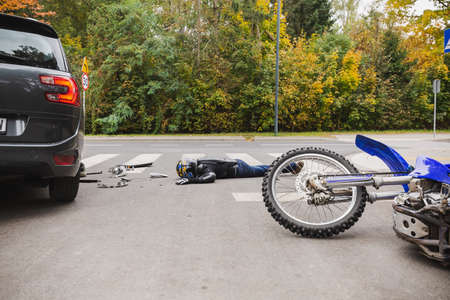 Tragic car and motorcycle accident with unconscious man