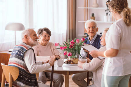 Group of senior people spending time together in the afternoon in living room Stock fotó