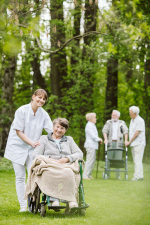 Elder and disabled people in the garden spending time together Stock fotó