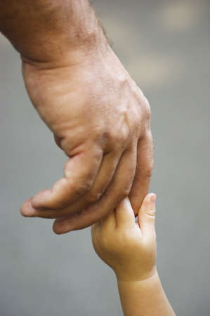 hand in hand , a baby hand is honding an adult hand Stock Photo - 5394815
