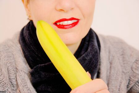 young woman with red lips in a provocative exhibition banana Stock Photo - 17980288