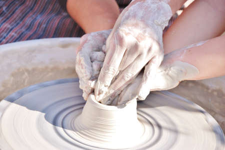 traditonal: wheel hands at work teaching art of the potter