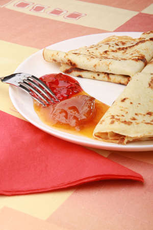 plate of tasty pancakes with jam on the table Stock Photo