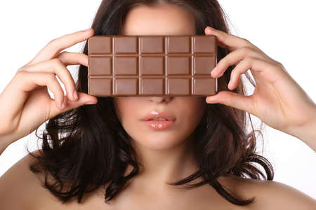 attractive woman covers her face with chocolate isolated on white Stock Photo