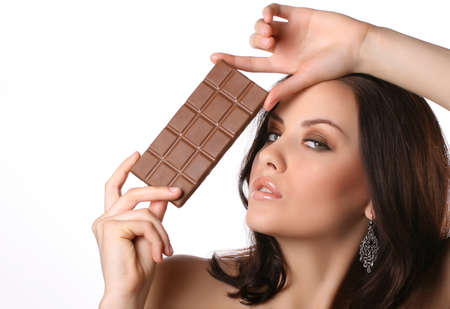 woman with chocolate on white Stock Photo