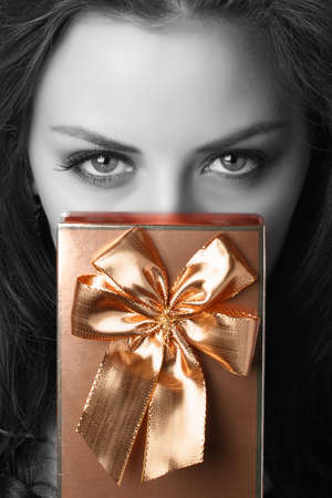 portrait of beautiful woman with present