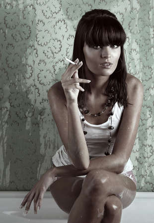 women smoking: attractive woman smoking in bath Stock Photo