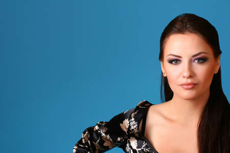 attractive young woman on blue background photo