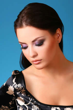 attractive young woman on blue Stock Photo - 6650743