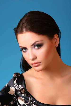 young attractive woman on blue