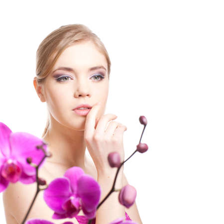 attractive young adult isolated on white background with orchid Stock Photo - 6650858