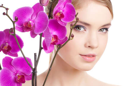 closeup of beautiful female with orchid isolated on white