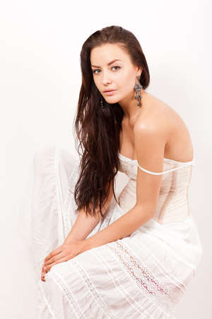bare shoulders: beautiful pretty tender woman with bare shoulders in white dress