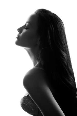 young woman face: closeup silhouette of attractive caucasian woman wearing bra