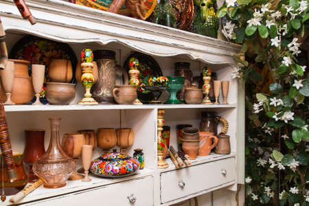sideboard: white sideboard with traditional handmade objects