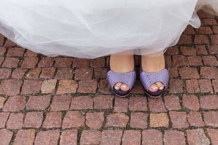 open toe: bride purple open toe shoes decorated with strass Stock Photo
