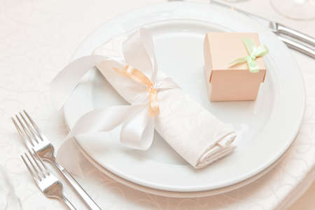 wedding table decor: wedding table appointments closeup with gift box. table setting