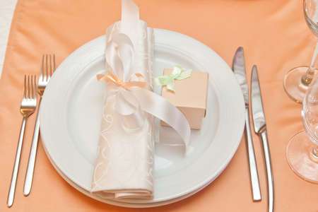 wedding table appointments closeup with gift box. table setting photo