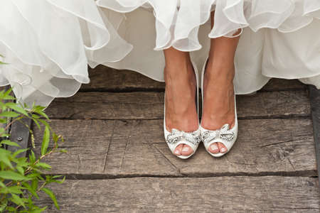 open toe: bride white open toe shoes decorated with bow and strass on wood boards