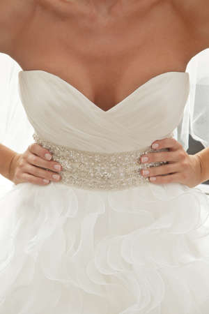 neckline: bride in luxury dress with plunging neckline, arms akimbo Stock Photo