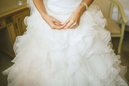 bride bangle: brides Hands on white dress Stock Photo