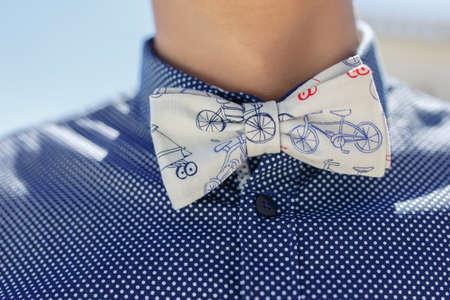 bow tie with polca dot shirt closeup