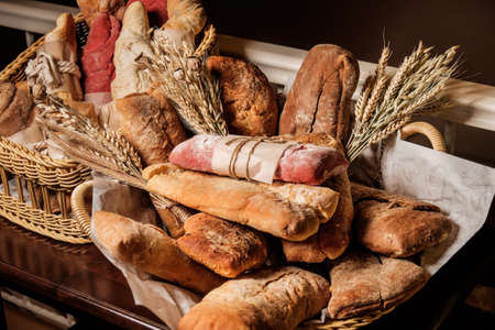 malted: variety of bread, ciabatta, grissini, malted and beet bread Stock Photo