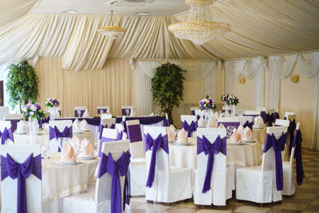 the place is outdoor: gorgeous wedding chair and table setting in purple color
