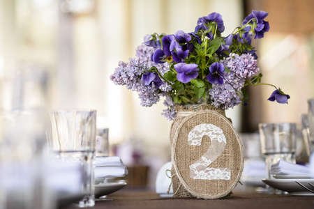 syringa: wedding table decor with syringa and pansy flowers, table number decorated with sack and lace
