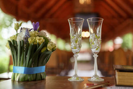 gauzy: wedding glasses of champagne and bouquet of beautiful flowers: eustoma, Muscari, Crocus