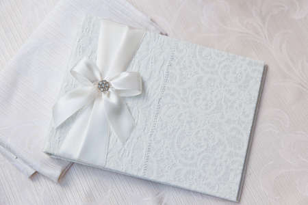 white wedding wish book decorated with bow and lace Foto de archivo