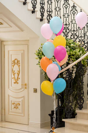 Celebration in luxurious interior with balloons