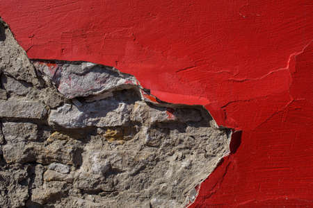 Red paint on concrete wall