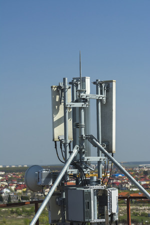 4G antenna an the roof, blue sky background, network communications, internet GSM, mobile phone Stock Photo
