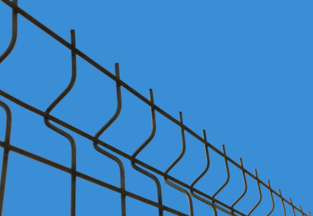 Blue background with fence mesh. Abstract background Steel fence Stock Photo