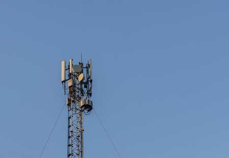 4G antenna an the roof, blue sky background, network communications, internet GSM Imagens
