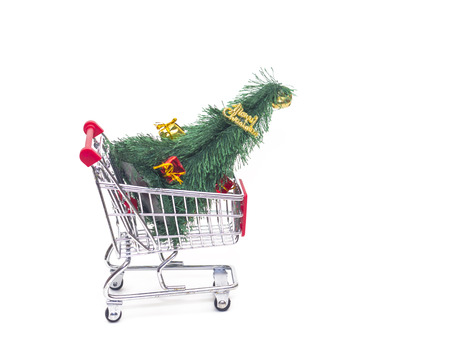 Shopping basket cart with christmas tree and ornaments Banco de Imagens