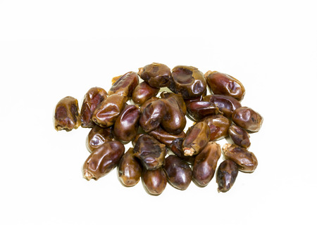 Dried of sweet dates. Pile of Dried Dates palm fruits on white background