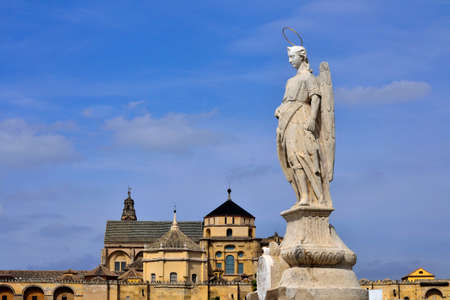 San Rafael Archangel Statue at Andalusia, Spain  St  Raphael Archangel Statue with Mosque Cathedral of Cordoba
