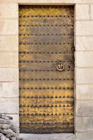 Golden moorish door of the Mosque Cathedral of Cordoba, Spain