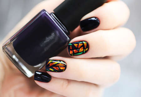 Trendy female manicure with nail art. Stock Photo