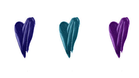 Blue, green and purple heart smear of lipgloss.Beautifull shimmer texture.Isolated on white photography.Horizontal banner.