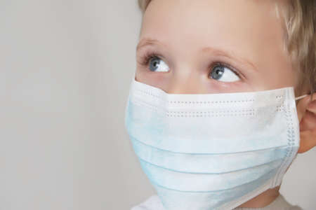 Child in blue medical mask.Close up photography.Protecting health from various viruses and diseases.Quarantine and disease prevention concept.