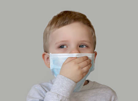 Child in blue medical mask.Close up photography.Protecting health from various viruses and diseases.