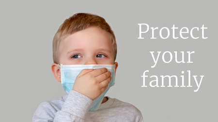 Child in blue medical mask closes his mouth with hand for coughing.Close up photography.Protecting health from various viruses and diseases.Quarantine and disease prevention concept.Family protection. 版權商用圖片