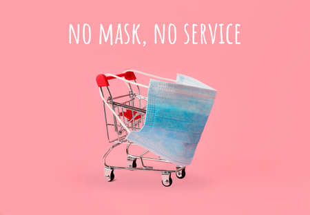 Shopping cart in blue medical mask.Concept of service during quarantine.Prevention from flu,coronavirus and other diseases.